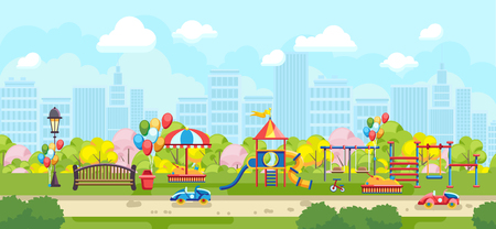 City park with colorful kids playground and bench on background of city buildings
