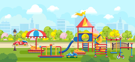 Colorful playground constructions on green meadow in city park on urban background