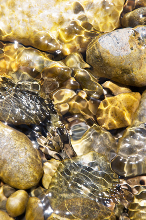 rocks in shallow water Stock Photo - 32310362