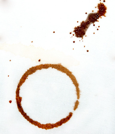 drops of coffee on a white cloth photo