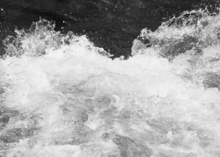 rushing water: splashes of water in the river