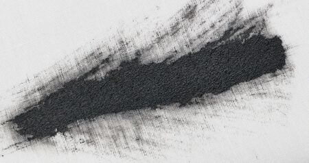 black spots of paint on white material photo
