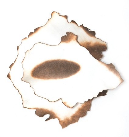 wadded: paper with charred edges