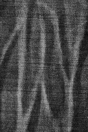 worn jeans: black and white worn jeans as a background