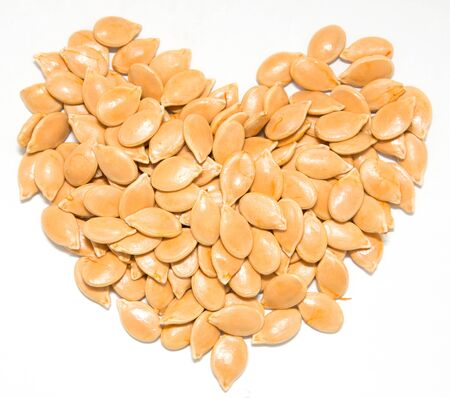 collation: pumpkin seeds on a white background Stock Photo