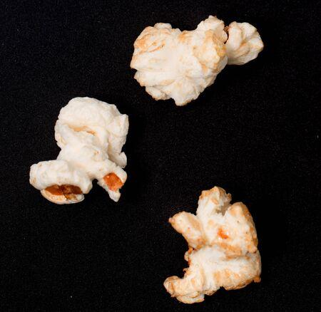 popcorn on a black background