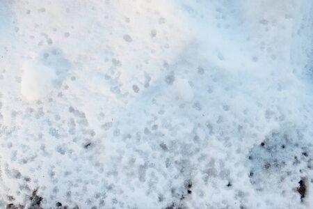 mud snow: footprints in the snow drops