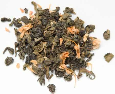 dry green tea with jasmine on a white background