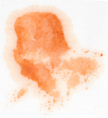 stain of ketchup on a white material