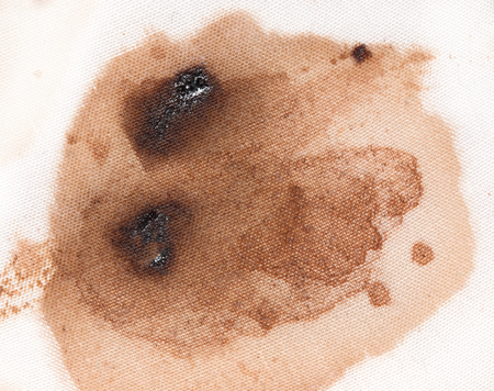 coffee stain on a white material photo