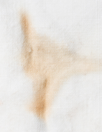 stain: brown stain on the white material Stock Photo