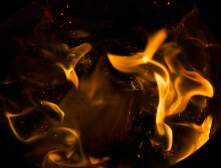 Fire flames on a black background 写真素材