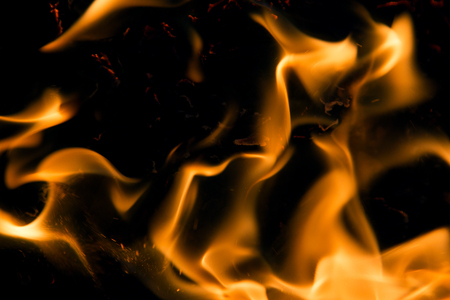 arsonist: Fire flames on a black background Stock Photo