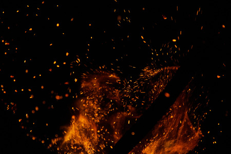 wood and fire: fire flames with sparks on a black background Stock Photo