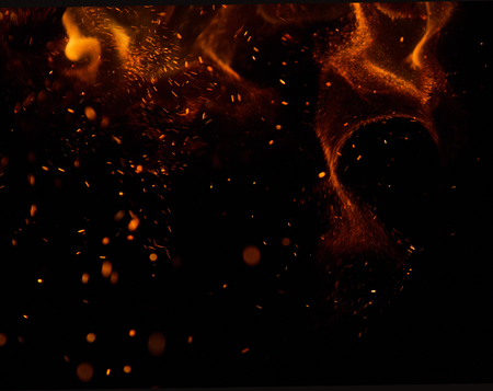 to black: sparks of fire on a black background Stock Photo