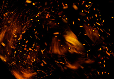 barbecue fire: fire flames with sparks on a black background Stock Photo