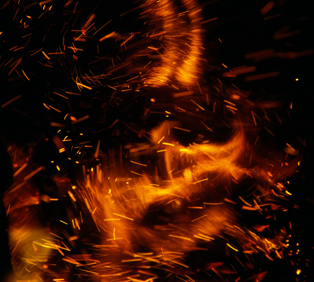 fire flames with sparks on a black background Standard-Bild
