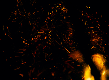 wood fire: fire flames with sparks on a black background Stock Photo