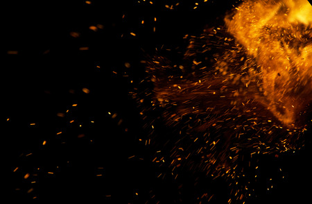 sparks of fire on a black background Stock Photo