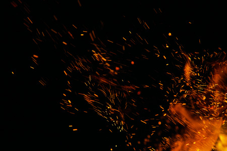 fire flames with sparks on a black background Banque d'images
