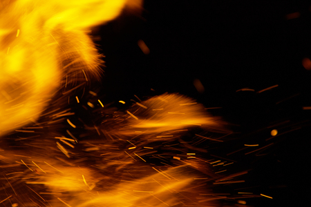 spark: fire flames with sparks on a black background Stock Photo