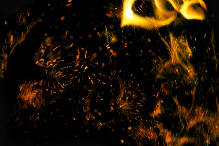 fire flames with sparks on a black background 写真素材