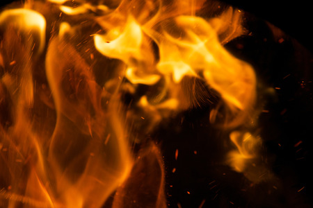 red and black background: Fire flames on a black background Stock Photo