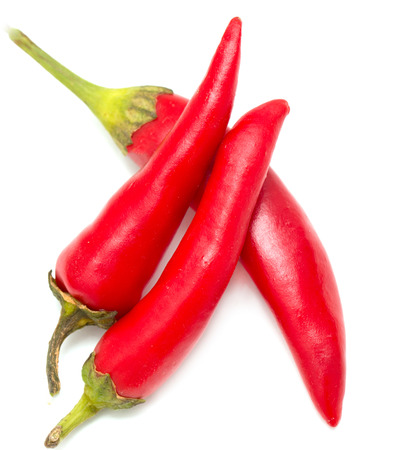 capsaicin: Red chili peppers on a white background Stock Photo