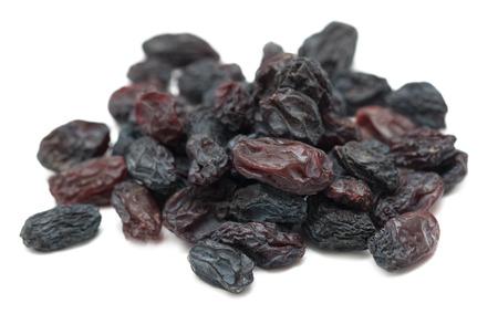 Black dried grapes on a white background Banco de Imagens