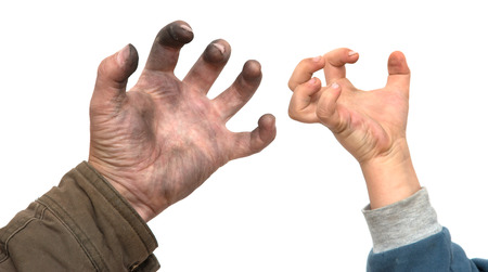 operating key: dirty mans hand with a childs hand on a white background Stock Photo