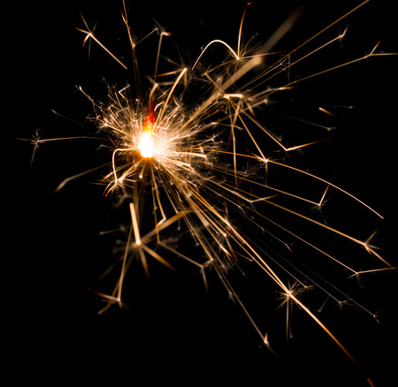 glow pyrotechnics: sparks of fire on a black background Stock Photo