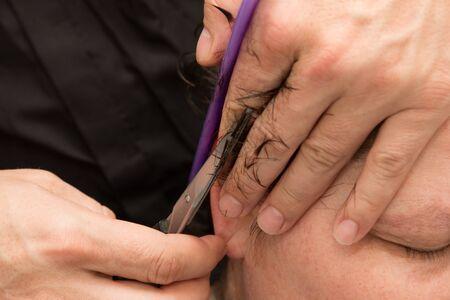 barber scissors: Barber cutting female hair with scissors