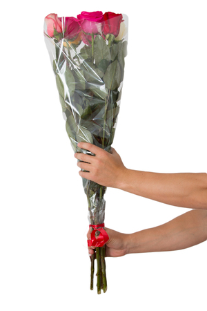 a bouquet of roses in his hand on a white background Stock Photo