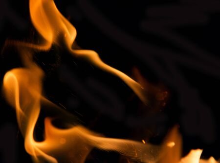 smolder: Fire flames on a black background Stock Photo