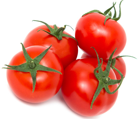 ripe tomatoes on a white background