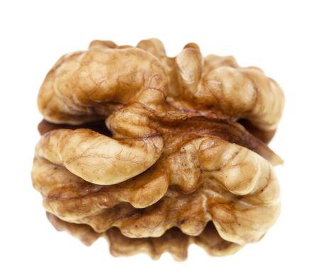 peeled walnut on a white background