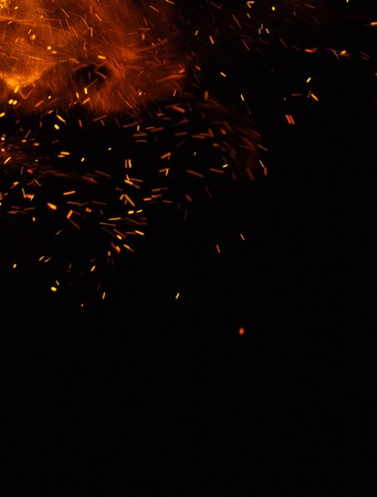 fire flames with sparks on a black background Stock Photo