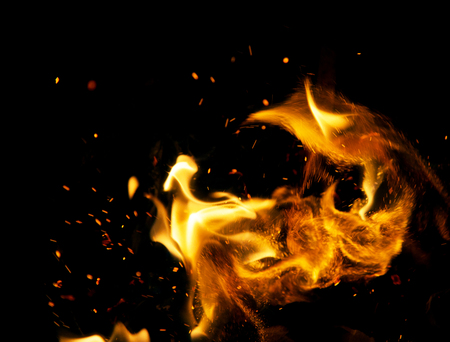 fire flames with sparks on a black background Banco de Imagens