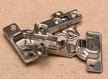Fixings for furniture on a wooden background