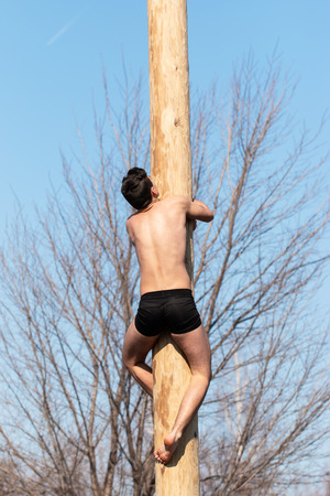 outdoor sports man on a wooden post