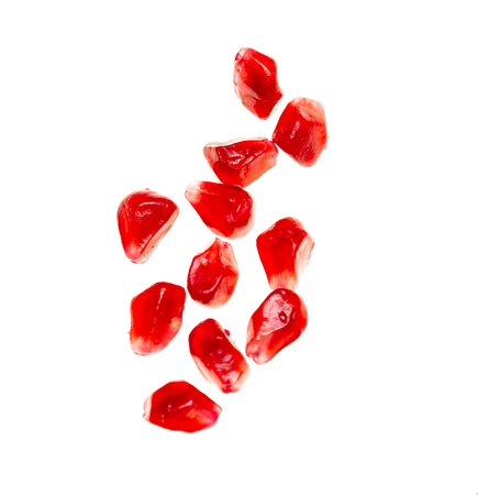 pomegranate seeds on white background 版權商用圖片