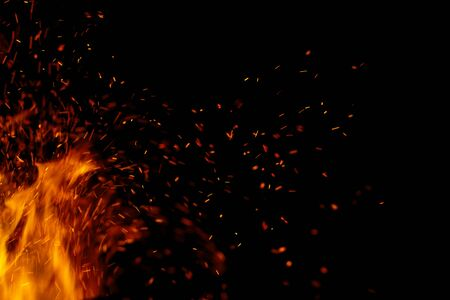 flame of fire with sparks on a black background 스톡 콘텐츠 - 129248543