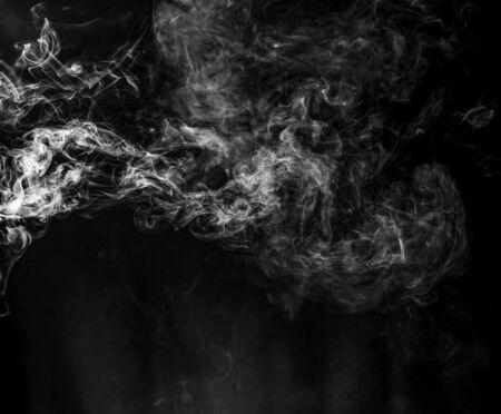 jet of gray smoke on a black background