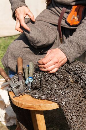 hands weave metal from rings