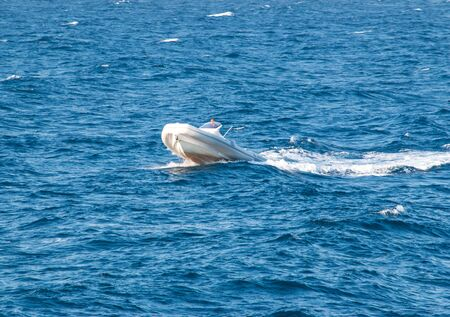 white boat on the sea waves Stok Fotoğraf