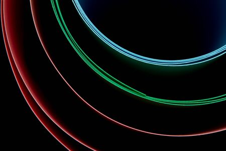 Mixed colors on a black background. Abstraction. 版權商用圖片