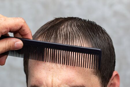 haircut men with scissors in the salon