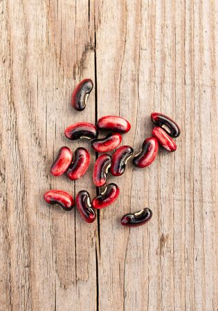red beans on a wooden background