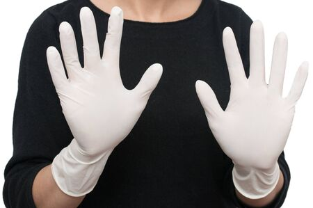 medical white gloves on his hands