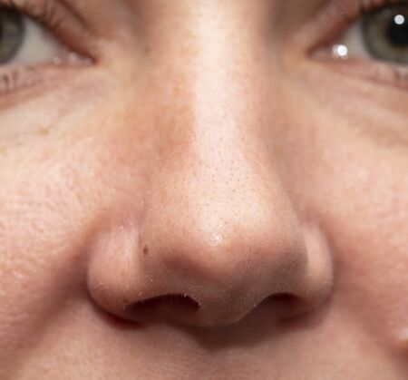 womans nose with clean fair skin Фото со стока